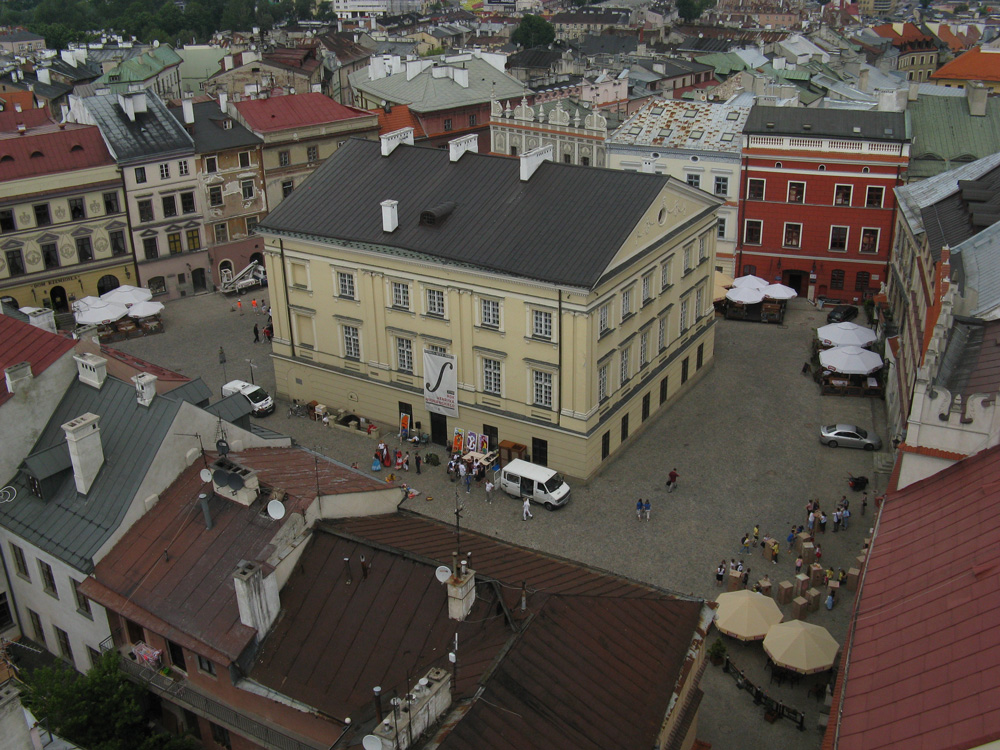 Photography of the Old Town Market Square with the Royal Tribunal building