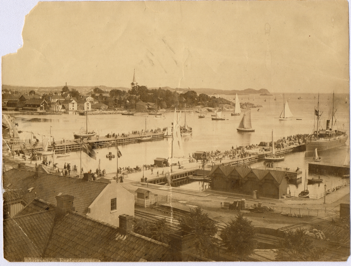 Larvik harbor with the old wooden boathouses next to the Skottebrygga