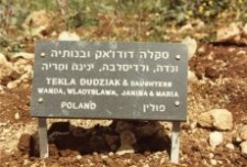 A commemorative plaque by the Tree of Remembrance of the Dudziak family