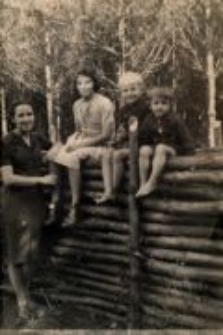 Lidia Hobbs (Damm) with her adopted siblings and Eufrozyna Trzeciak