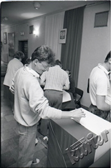 Casting the ballot at the voting booth in one of the municipal voting committees in Lublin
